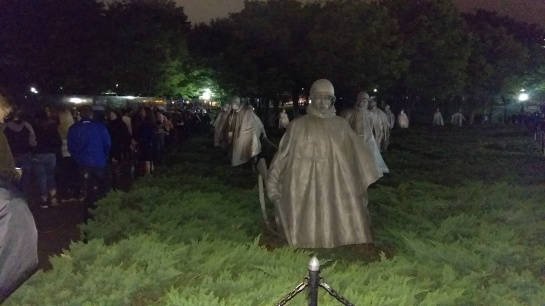 Statues of 19 soldiers marching out of the trees in the Korean War Memorial